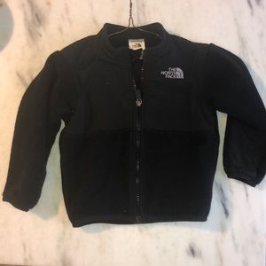 Black Northface fleece jacket.